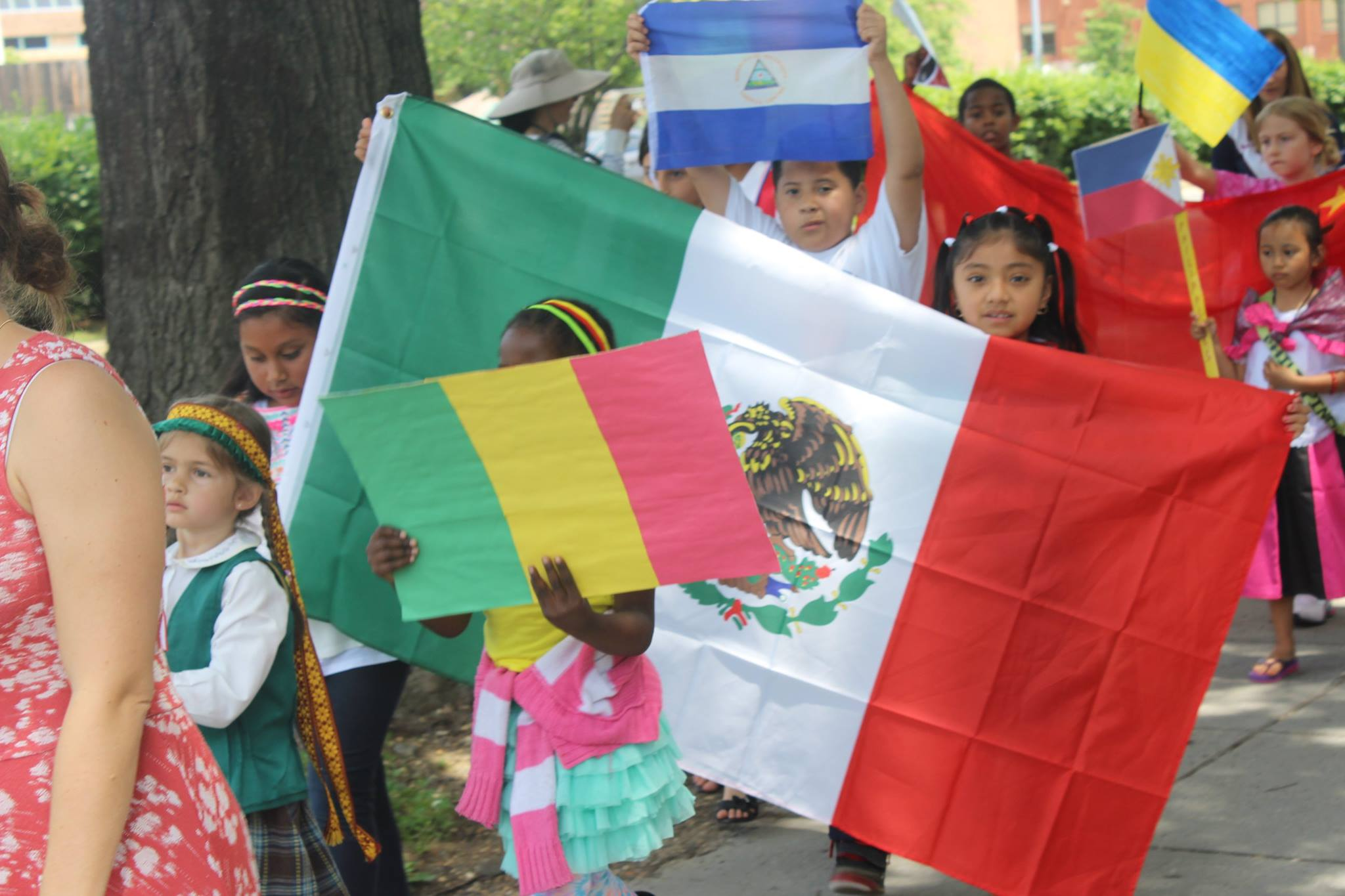 Students from Seaton Elementary walk in the Parade of Nations